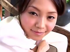 Cutie Nami Mutou loves stimulating her clit on the bed